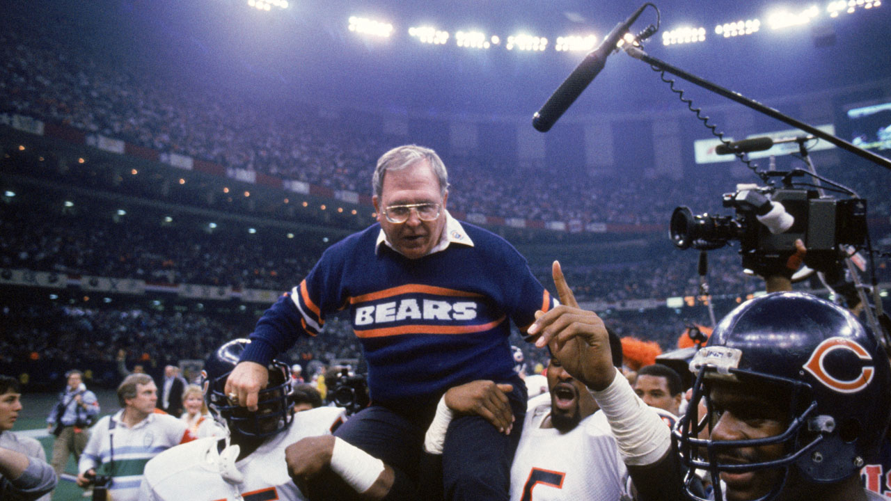Buddy Ryan carried off the field-118809342