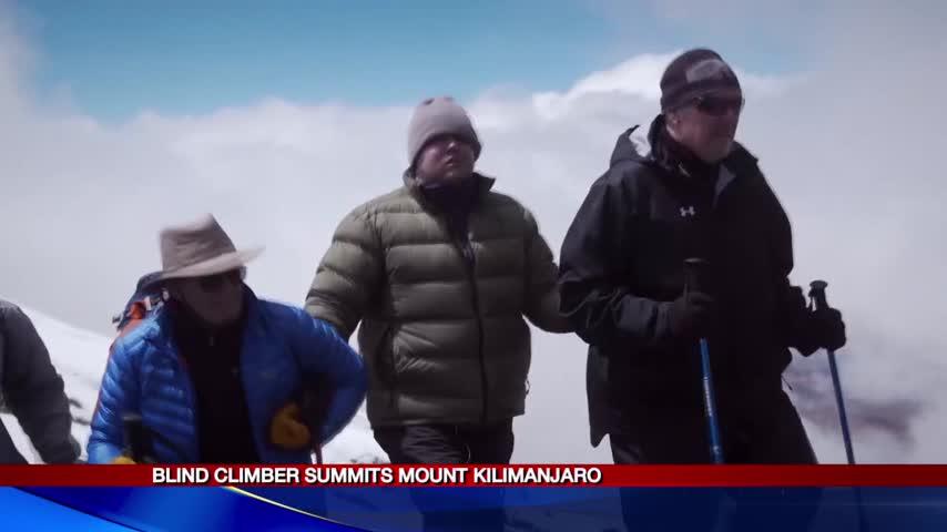 Blind CNY climber summits Mt- Kilimanjaro_32691031-118809342