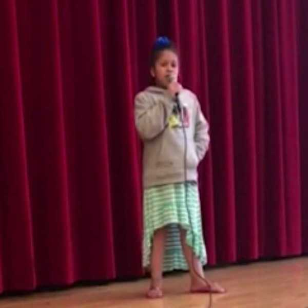 Aleysha Rosario, singing at Youngstown school talent show